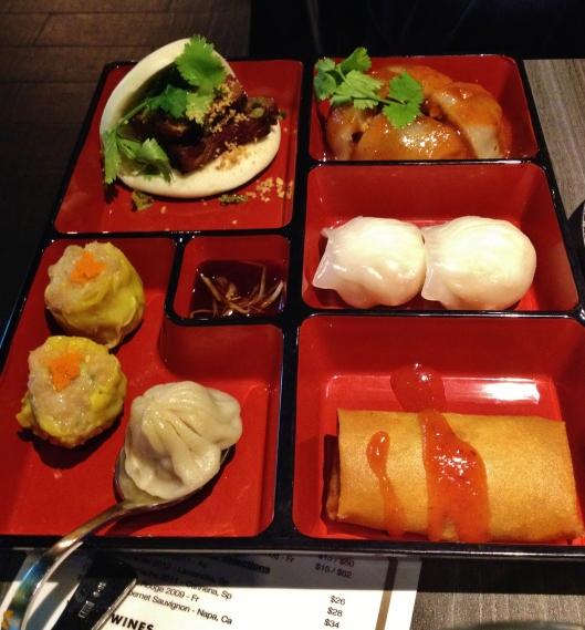 CW from top left: Pork Belly Slider (Gua Bao), Taiwanese pork meatball (Ba-wan), shrimp dumpling, Fried spring roll with taro, Xiao-long-bao (stead soupy pork bun), pork and cabbage Siu Mai.