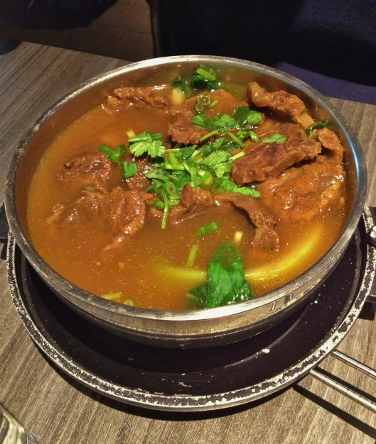 Tender beef with asian vegetables in a spicy broth.