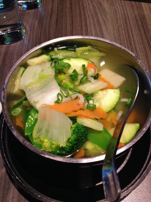 broccoli, carrot, mushrooms, zucchini,  tomato and peapods in lemon broth