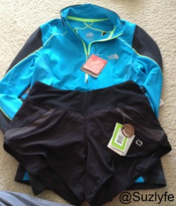 North Face techical shirt--It has a wind breaking layer as well as vents. Moving Comfort Shorts.